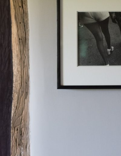 contemporary photography by wooden beam