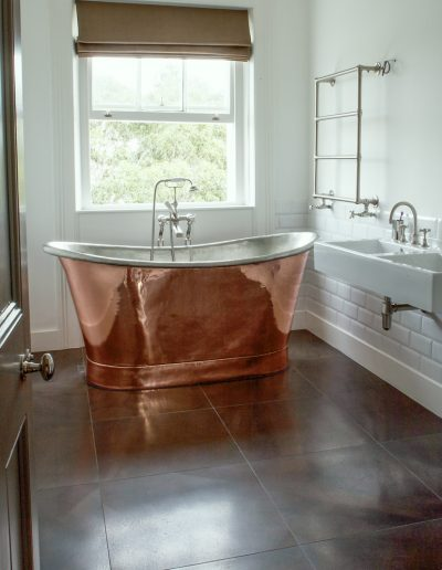 copper bath with leather tiles