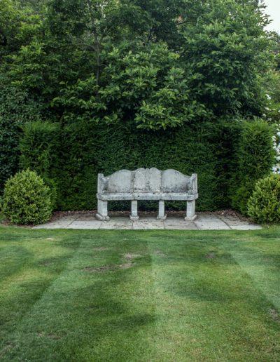 Stone seat in garden