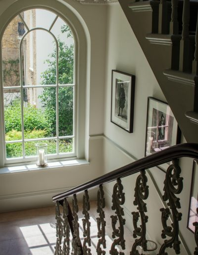 Classic Stairway with View of Rear Garden