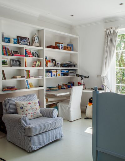 Childrens Bedroom with Soft Arm Chair and Bookshelves