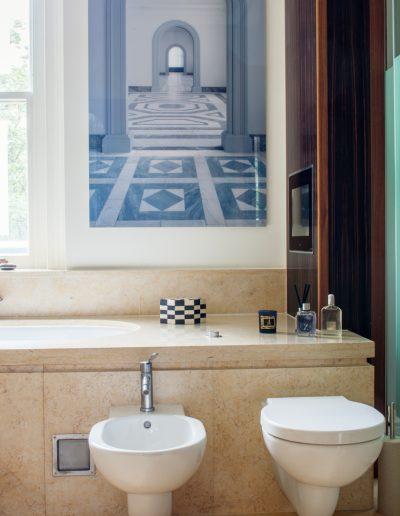 Bidet and Toilet in Marble Bathroom