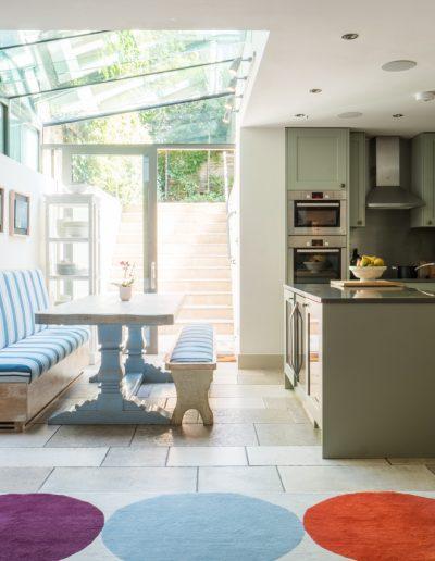 Modern kitchen with glass garden extension