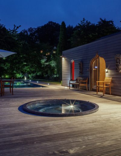 Swimming pool & Jacuzzi outside Moorish summer house at night